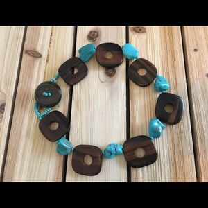 Wood and turquoise colored bead necklace